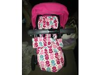 Mamas and papas pink pushchair with foot muff