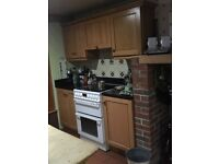 Kitchen and utility cupboards with black granite worktop