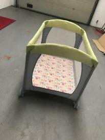 Mothercare travel cot with wheels