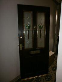 LEADED GLASS FRONT DOOR. USED