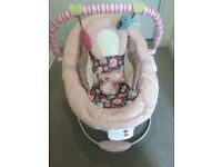Pink comfort and harmony vibrating bouncer seat