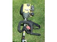 Ryobi Expand-It 30 cc 4-stroke power head with line trimmer attachment.