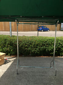 John Lewis chrome clothes rail with basket - 173 by 140 by 50 cms - on wheels - good solid unit