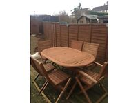 Table and 6 chairs 2 loungers and side table and brand new cushions