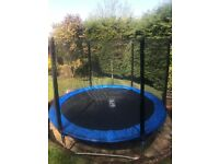 Kids trampoline. 10ft diameter. Complete with safety net, ladder and cover.