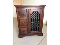 Dark wood CD cabinet with 3 drawers and 1 cupboard