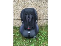 Maxi-cosi child's car seat, dark grey with black straps.