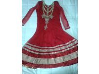 Wedding dress comes with FREE trouser & veil.Red coloured with gold embroidery.Size: Medium.Stunning