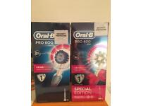 2 Oral-B Pro 600 electric toothbrush Blue and Pink colour
