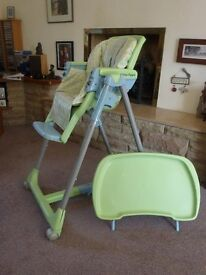 Highchair in excellent condition, adjustable and folds down into a buggy