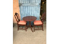 Antique Small Round Tripod Table & Two Chairs.