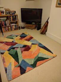 Colourful geometric living room rug