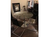 Beautiful round glass table with 4 retro style chairs (2 brown, 2 clear). All in Great condition.