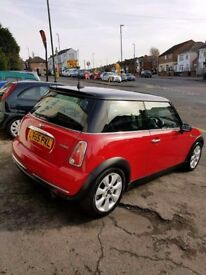 Just arrived in stock this lovely Mini Cooper 1.6 05/55 finished in bright red with a black roof