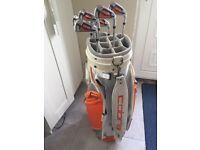 Cobra irons and golf trolley bag
