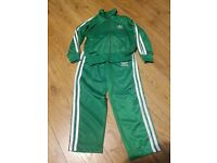 Adidas green tracksuit for 6 years old kids brand new....