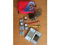 Grey Nintendo DS lite with SuperMario case, games and charger