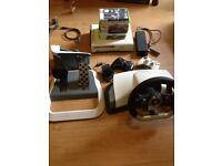 Xbox 360 console, steering wheel, 2 controllers. Lots of games