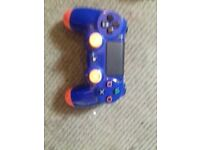 BLUE AND ORANGE / PS4 CONTROLLER / FULLY WORKING AND MO DD ED /FOR SALE OR SWAP ME ?