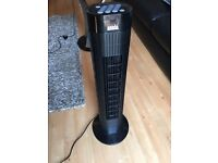 Black Tower Fan (with remote). Like-new.