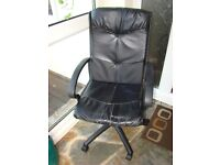 Black faux leather office swivel chair with arms.