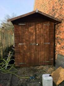 2m x 3m garage style shed.