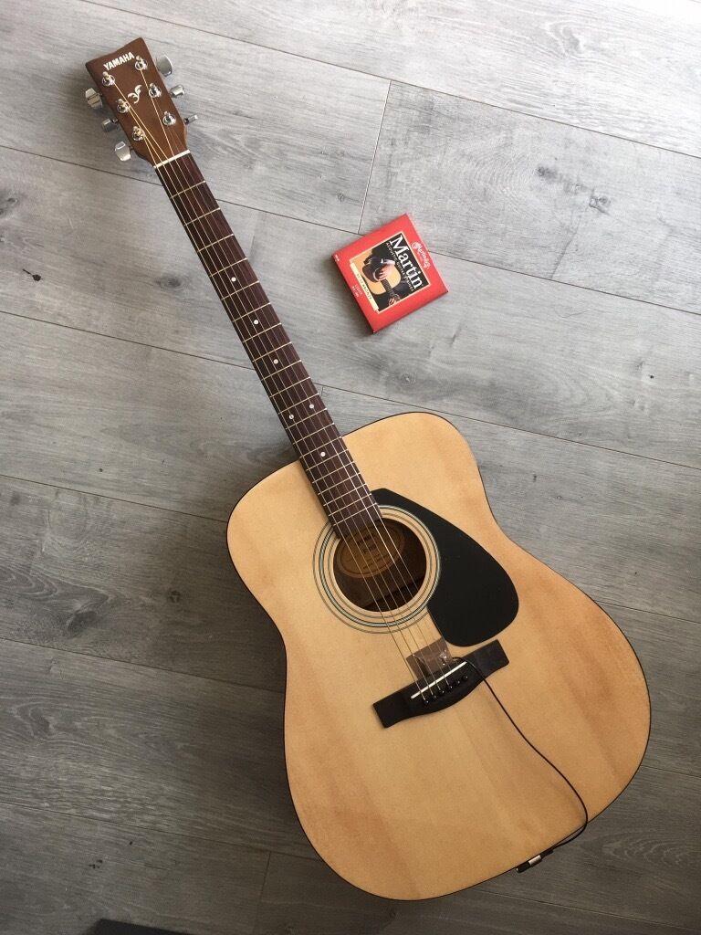yamaha f310. yamaha f310 acoustic guitar with piezo pickup and a bag