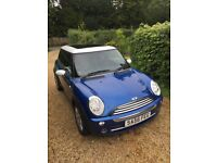Blue Mini Cooper with sunroof and chili pack 2006