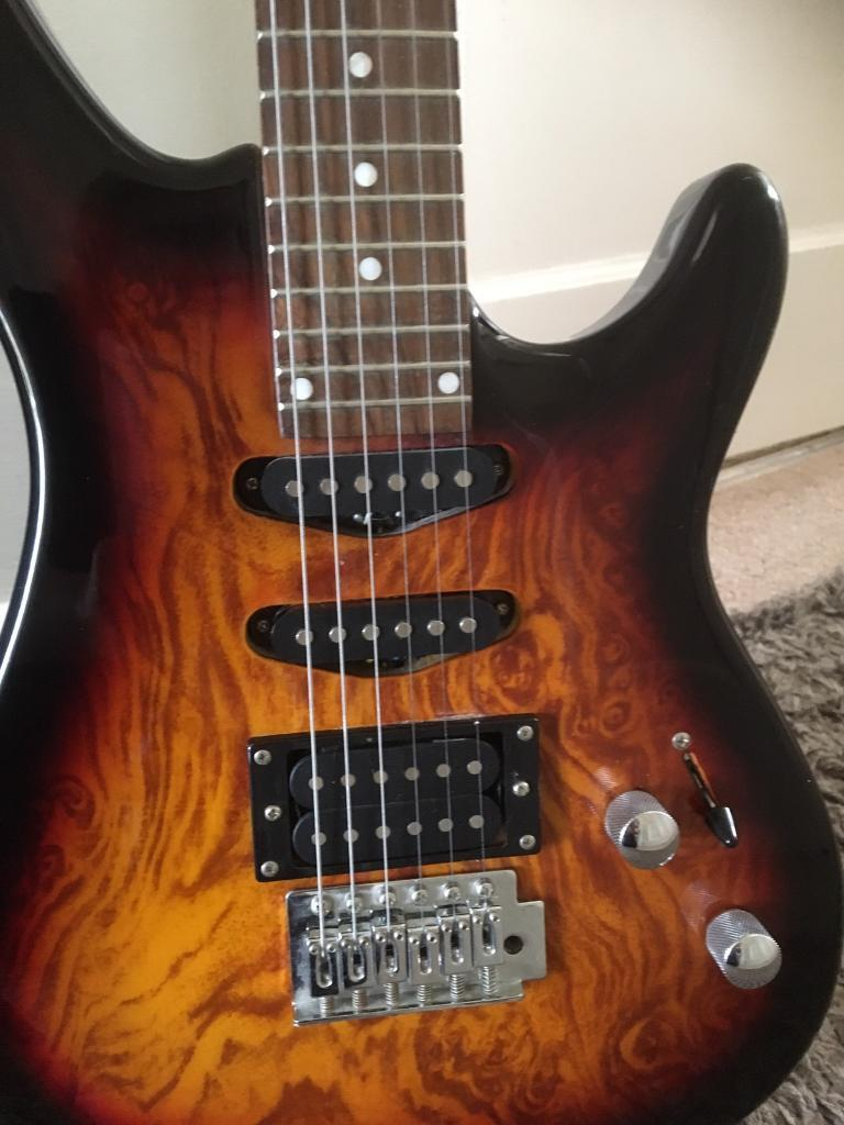 Wesley Electric Guitar ,As new barely used cherry red with strap ,bag and stand