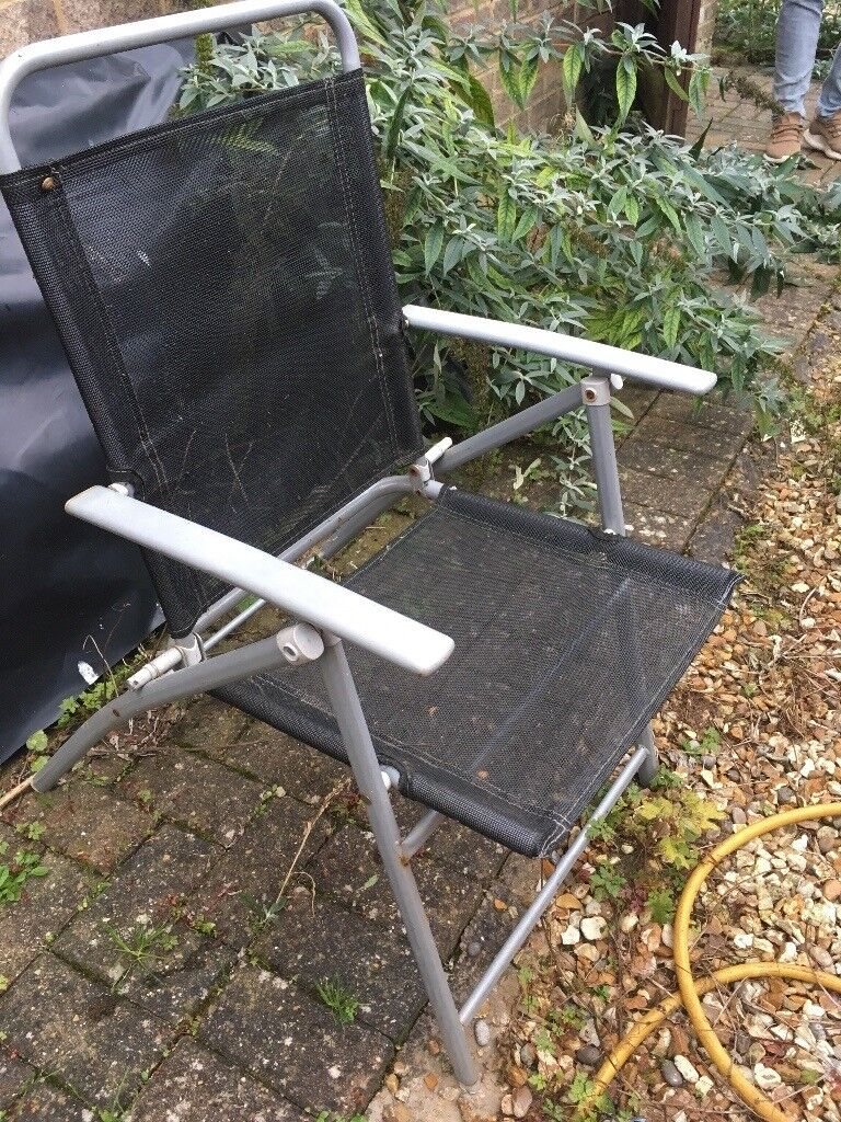 Set of four foldable garden chairs