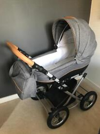 Stunning Gray Baby Pram , excellent condition. You can swing/rock Baby in.