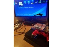 Used PS4 with controller and 2 games