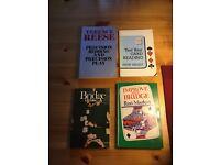 Various books on contract bridge.