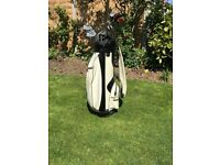 Mizuno golf bag, clubs and golf trolley.