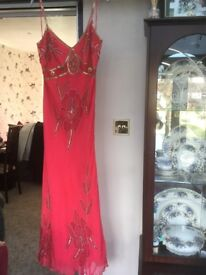 """Planet"" red and gold long evening dress."