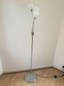 Three bulb arc floor lamp in chrome. 160 cm high