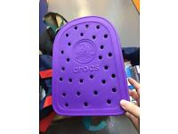 Brand new never used purple Crocs back pack