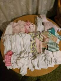 New born and first size baby girl bundle including pram suit