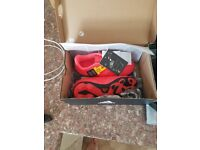 Childs size 11 addidas football boots and shin pads