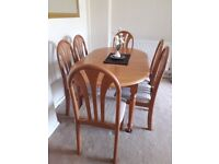 Dining room extending table and 6 chairs