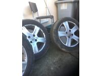 4 Peugeot alloy wheels.