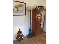 Antique carved and turned wooden floor lamp with retro shade