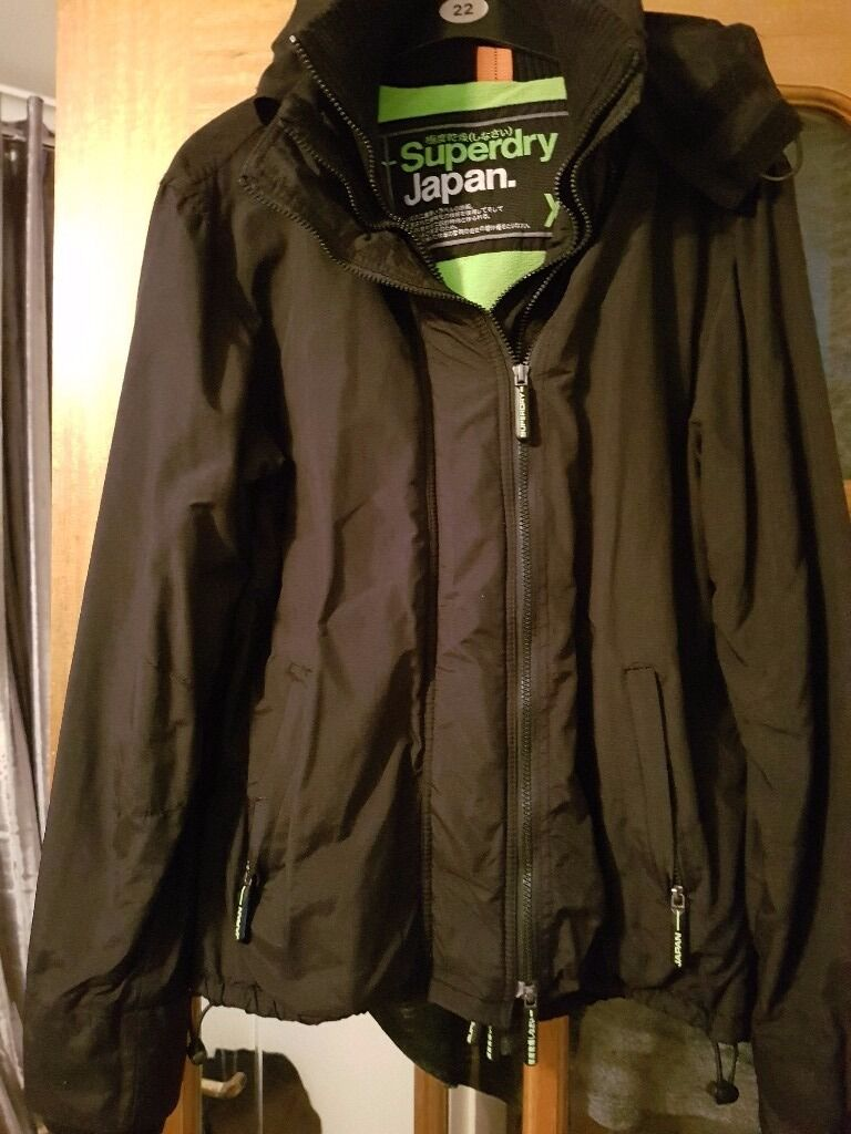 SUPERDRY jacket with green fleece lining size XL but more a Large
