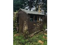 Wooden garden shed / hut