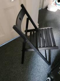 Folding black wooden chair