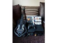 Sony PlayStation 3 with guitar hero and loads of games