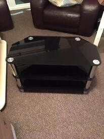 Black glass and silver Tv cabinet and table to match