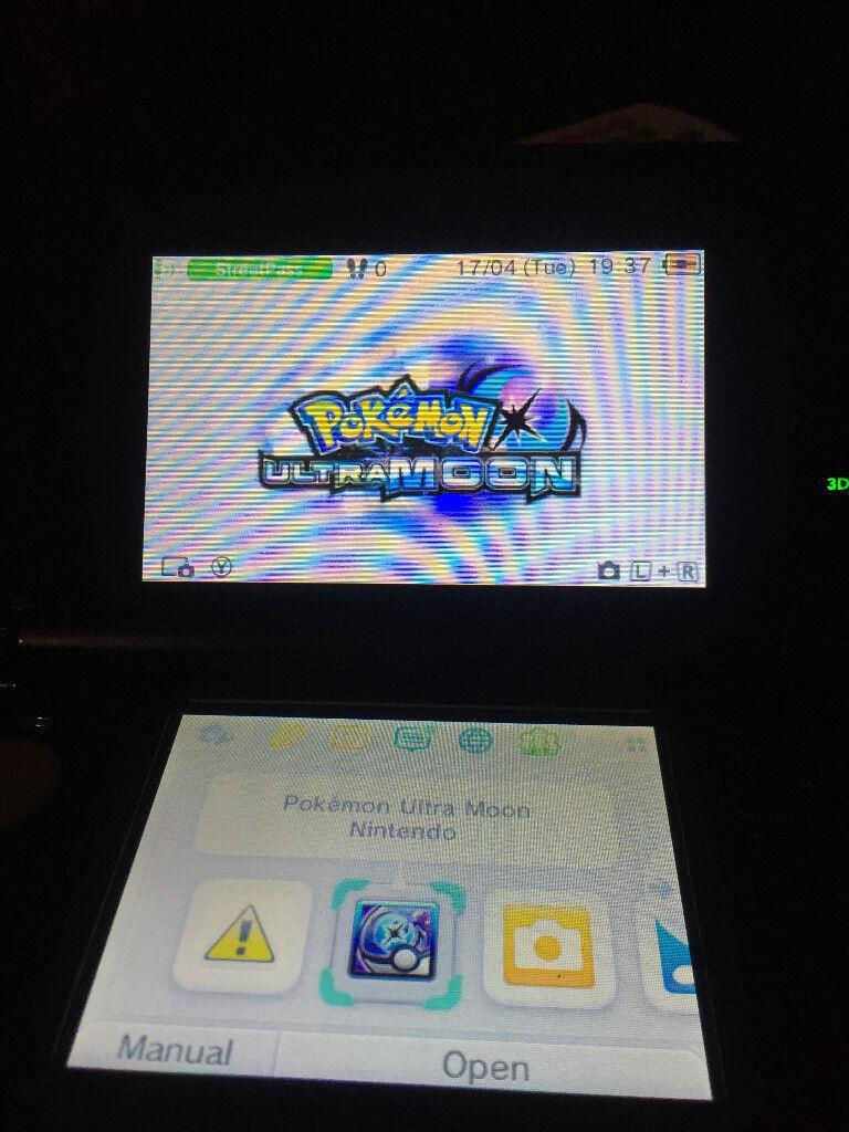 Black Nintendo 3ds with Pokemon ultra moon