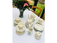 6 teacups and saucers, bread plates, coffee pot, tea pot, creamer, sugar bowl. Barely used.