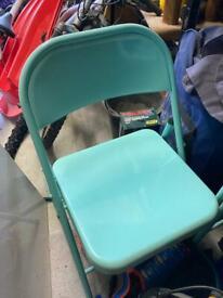 Four Folding metal chairs